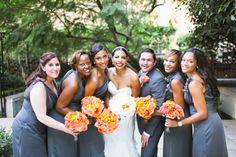 Grey bridesmaid dresses with bright orange bouquets