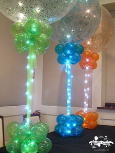 Balloon Centerpieces · Party & Event Decor · Balloon Artistry Sparkle Balloons with Rice Lights. Balloon Columns, Balloon Arch, Balloon Ideas, Balloon Topiary, Balloon Stands, Balloon Designs, Balloon Tower, Balloon Lights, String Lights