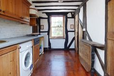 (PHOTO CREDIT: Zoopla)  Could you live in one of these tiny houses? Littlehampton, West Sussex The kitchen of the Littlehampton house (It simply wouldn't be possible to pack any more period features into this tiny nineteenth-century home. Its living room, kitchen, bedroom, bathroom and study boast original fireplaces, stained glass windows, sash cord windows, beamed ceilings and walls with carvings attached. Outside, a small courtyard garden is enclosed by pretty flint walls, and the...)