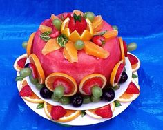 """Watermelon """"cake"""" - use other fruits to decorate it - use small cookie cutters to cut leaves and flowers out of honey dew and cantaloupe instead of the orange slices. Vegan Desserts, Raw Food Recipes, Vegan Cake, Fruit Cake Watermelon, Fruit Cakes, Food Carving, Savoury Cake, Clean Eating Snacks, Fresh Fruit"""
