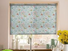 Our Bella Teal and Coral Roller blind is the perfect alternative to a striking wallpaper, adding just the right amount of fun to your room. #blind #blinds #roller #statement #window