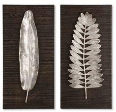"Distressed, dark ebony-stained wood is the perfect backdrop for brushed aluminum leaves on this paired set of nature-inspired wall art. <ul> <li>12"" x 24"".</li> <li>Aluminum/MDF.</li> <li>By Uttermost; imported.</li> </ul>"
