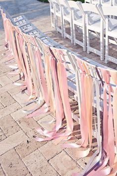 I like these chairs for the reserved family chairs at the ceremony..of course ribbons in our colors