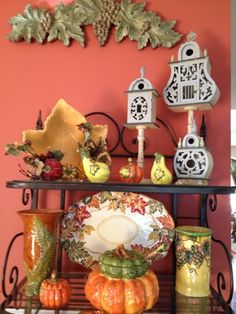 Bakers rack with fall pottery.