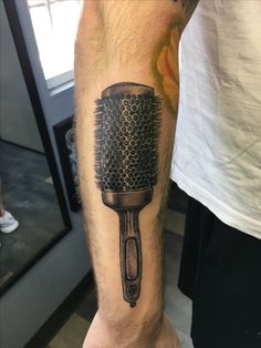 Hairstylists hairbrush Tattoo by: Nephtali Brugueras jr.