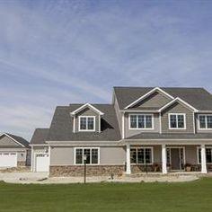 Two Story Home Enhance The Designed Exterior