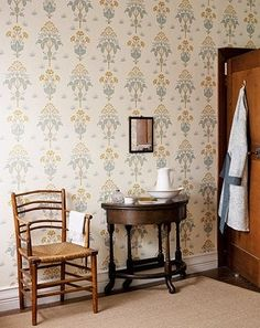 Meadow Sweet Wallpaper An arts and crafts floral style wallpaper in rose and olive green on a cream background.