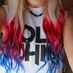 Blond dyed color hair with red purple and blue bottoms tips. Colour block hair. Funky.