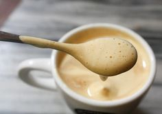Delicious Vietnamese egg coffee (ca phe trung). Rich espresso topped with a meringue like fluff made of whipped sweetened condensed milk and egg yolk.