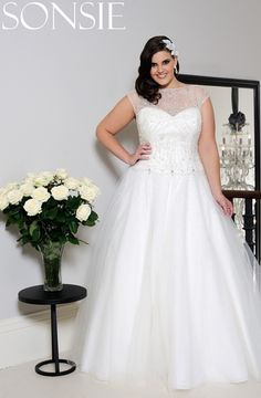 2916c9e27f0 Next stop  SON91465 Beautiful sheer illusion boatneck wedding dress with  full tulle skirt. Gorgeous