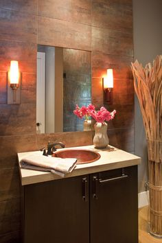 cool color combo! love the copper sink and that the mirror is mounted flush with the tile!