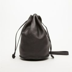 Rank & Style Top Ten Lists | BAGGU Leather Drawstring Bucket Bag #rankandstyle