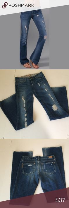 Paige Laurel Canyon Distressed Bootcut Jeans, 27 Paige Laurel Canyon Distressed Bootcut Jeans in size 27. Flat lay measure of the waist is 15.25. Rise is 7.5, inseam is 34, and leg opening is 9.5. Features factory distress, fading and whiskering. Made from 98% cotton and 2% spandex. In excellent condition, please ask if you have any questions. Paige Jeans Jeans Boot Cut