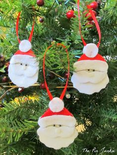 Easy to make felt Santa ornaments.  Use as an ornament on the tree or a gift topper.  Pattern included!