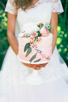 Small wedding cake decorated with flowers and vines. This could be perfect for a garden wedding!