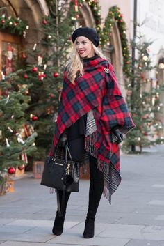 Christmas in Germany: red plaid ruana poncho, Chanel gold brooch pin, black cashmere beret, Stuart Weitzman black Highland over the knee boots, plaid poncho holiday outfit, red plaid reversible ruana outfit
