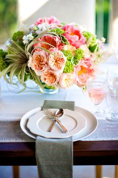 Modernly elegant place setting with striped linen