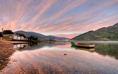 Sunrise at Okiwa Bay in the Marlborough Sounds New Zealand.