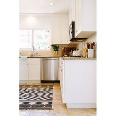 Kitchen With Contrast Cabinets Color White Perimeter Cabinets