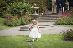 Flower girl playing with her toys on the grounds of The Castleoaks Hotel, Castleconnell, Co. Limerick