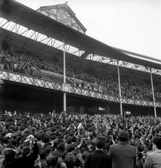The Everton team appear in the directors box under the Goodison gable as fans flood to celebrate the Toffees' Division One League title success, 1963 Everton v Fulham - Goodison Park