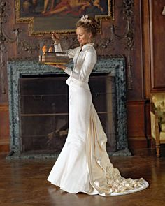 Stunning Victorian wedding dress. Cream color compliments different skin tones. Shapeliness is sexy and the length of the sleeves and high neckline add modesty as well.