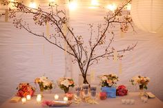 tree to hange wedding photos on....berry branches?  decorate with flowers - love the peonies in small bowls