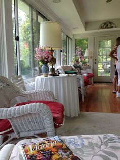 Sun room with pops of color. Classic.