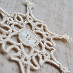 White Tatted Button Snowflake with Antique Button - so pretty
