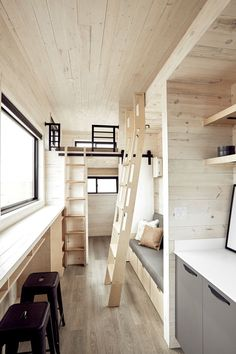 The interior is finished with white-washed pine walls and ceilings, and light colored waterproof luxury vinyl plank flooring throughout. Small Tiny House, Tiny House Cabin, Tiny House Living, Tiny House Plans, Tiny House Design, Tiny House On Wheels, Living Room, Living Area, White Washed Pine