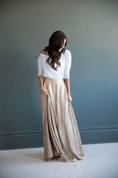 Add a corset top with sheer sleeves?