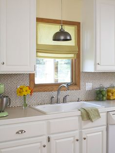We love this classic penny tile backsplash! See more ideas: http://www.bhg.com/kitchen/backsplash/kitchen-backsplash-ideas/