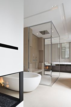 large bathroom in earthy tones, large tiled shower seat plus a glassed-in fireplace. #bathrooms #fireplaces #shower seat