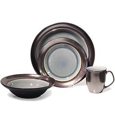 The unique Baum Stellar Dinnerware Set features a gorgeous metallic pewter finish with a transparent crackle glaze. This glamorous set is crafted of durable stoneware and is microwave and dishwasher safe.