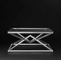 RH Modern's Empire Square Coffee Table:A dynamic double pyramid is the striking centerpiece of our 1970s-inspired table. An interpretation of a classic X-brace design, its tubular metal base supports a clear glass top that shows off its distinctive geometric form.