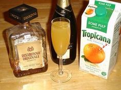 Disaronno, OJ and Champagne..YUM