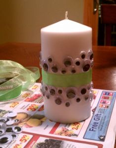 Googley eyes, ribbon and glue add a little extra to Halloween candle decor!