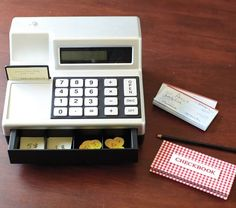 I was obsessed with my cash register as a kid... back when stores still stuck price labels on things.  Toy cash registers are great for teaching kids math in the concrete, using something everybody likes and should understand- money.  You cannot go wrong, getting a kid a cash register, I think.