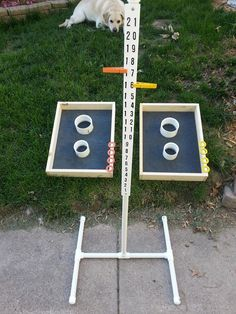 """Two hole washer toss from 3"""" PVC, 4"""" PVC, 1/2"""" plywood, and 1x4 pine boards.  Yard Game Score Keeper made out of 3/4"""" PVC pipe and PVC board."""