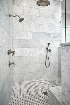 The Walls Are Honed White Carrera Marble Installed In A Traditional Subway Pattern Using Larger Format Tile Shower Floor Is AMore
