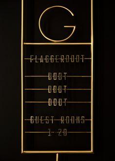 FABIO ONGARATO DESIGN; gold wayfinding signage