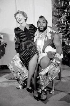 Nancy Reagan sitting on Mr. T's lap. No biggie.