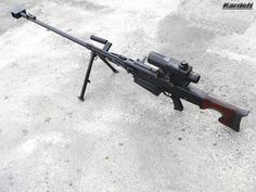 OSV-96 large caliber sniper/anti-materiel rifle. Caliber: 12.7x108mm, Operation: gas operated, rotating bolt Barrel: 1000 mm, Weight: 12.9 kg less ammunition and telescope sight, Length: 1746 mm (1154mm when folded), Feed Mechanism: 5 rounds detachable box magazine