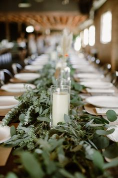 Dinner reception set-up on long wooden tables with eucalyptus greenery florals for Bohemian wedding at Smoky Hollow Studios wedding table Wedding Table Centerpieces, Wedding Flower Arrangements, Wedding Reception Decorations, Flower Centerpieces, Table Decorations, Wedding Ideas, Centerpiece Ideas, Reception Ideas, Bohemian Wedding Reception
