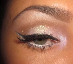 Ooh, very Xtina! Cat eye w/neutral glitter on the lids & pink shadow in the inner corner & along the lower lashline.
