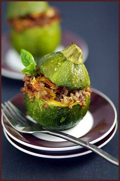 Stuffed Zuchini- hmm Ive made stuffed peppers before...tons of variations of this to be made.