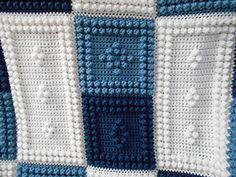 """NEW for 2014 this crocheted blanket is an original design that is easy to complete. The entire blanket requires only three crochet stitches - chain stitch, single crochet and the popcorn stitch. The pattern includes the instructions, a list of materials and the yarn amounts needed for a finished blanket approximately 47"""" x 61"""". The pattern can be customized to your own color choices. Also, rows can be added or taken away to create the size you would like."""
