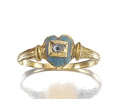 GOLD, ENAMEL AND DIAMOND RING, MID 17TH CENTURY.   The bezel designed as a stylised heart embellished with green enamel, to a central rose-cut diamond highlight