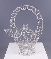 Anthony Foo uses steel mesh and paperclay slip. http://antjhfoo.blogspot.co.uk/2012/02/from-flat-mesh-to-3d-part-2.html