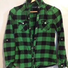 Green and black flannel top Great condition worn a handful of times but too small for me it does have a snap button on both sleeves in case you want to roll them up and button it. Tops